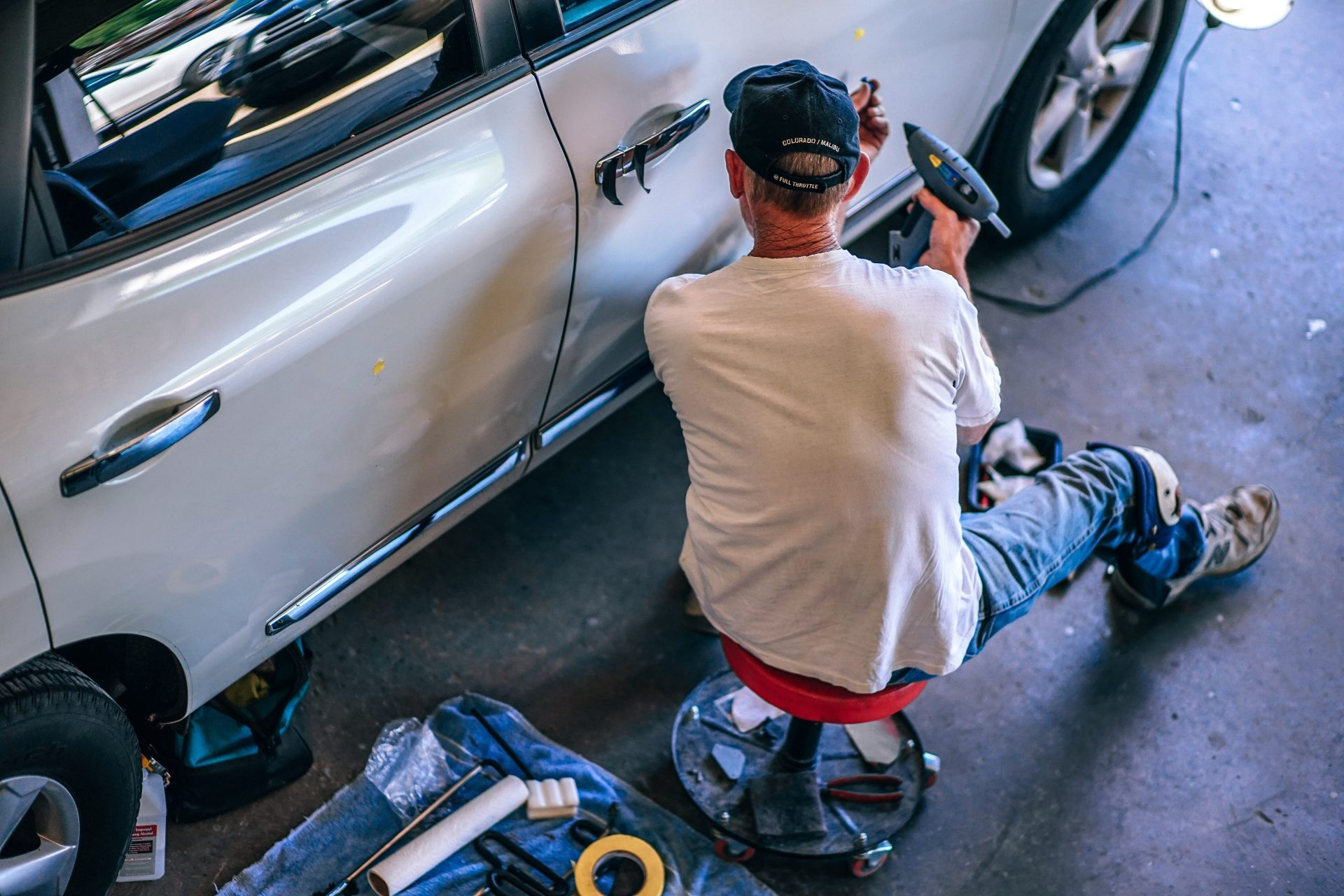 guy working in an auto body shop