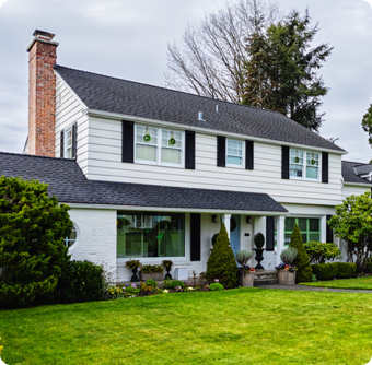 colonial style home exterior on a bright overcast spring day